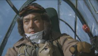 Lt. So Kofukuda in A6M2 cockpit.jpg