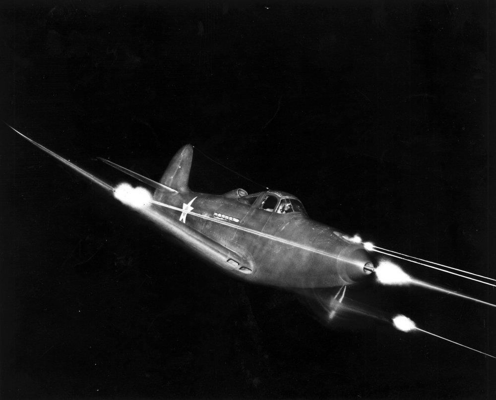 bell_p-39_airacobra_in_flight_firing_all_weapons_at_night.thumb.jpg.2d659129665610e0a709d557fdda4258.jpg